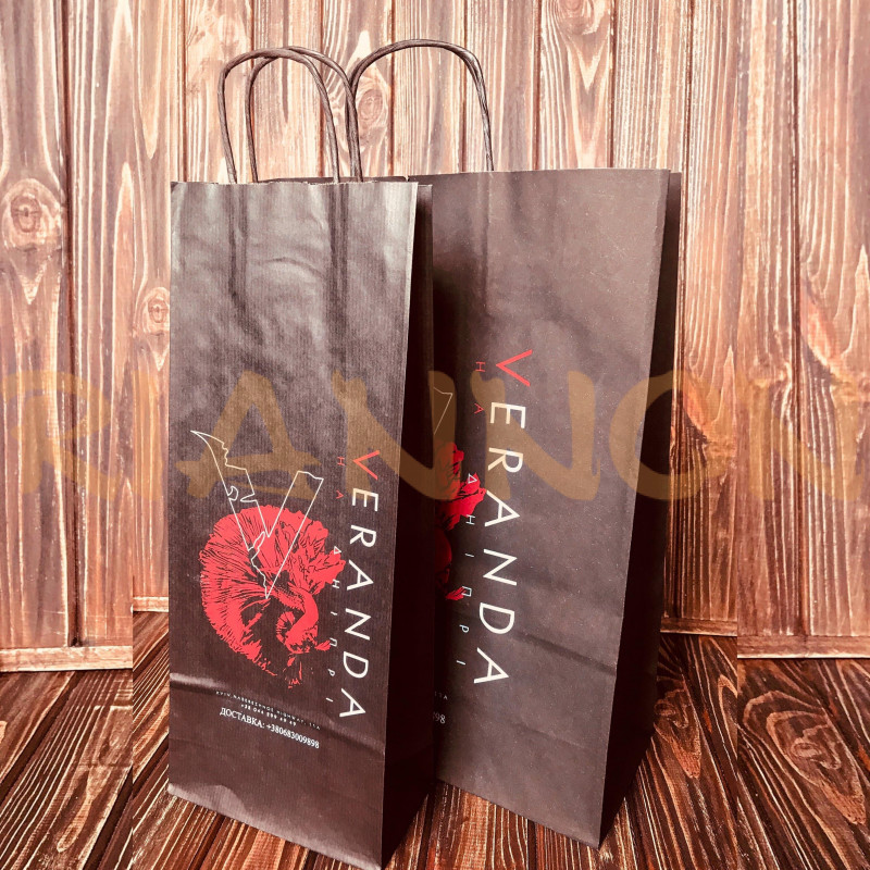 Bags with a twisted handle made of black craft paper